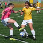 Oak Bay's Holly Goodacre battles for the ball vs Stelly's in the Ryan Cup Final